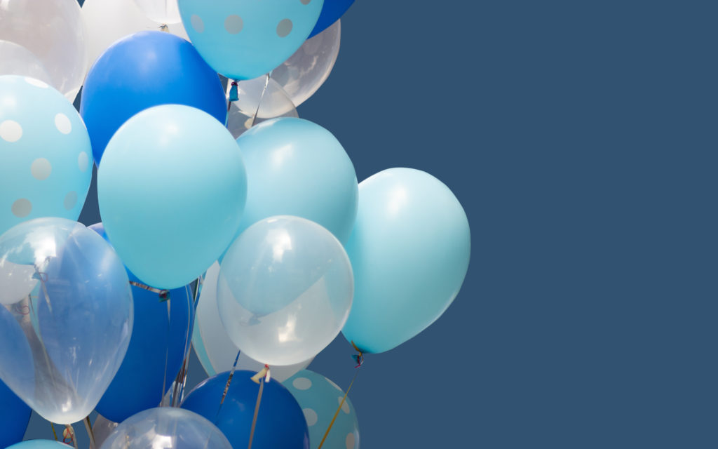 A big bunch of balloons in shades of blue and white